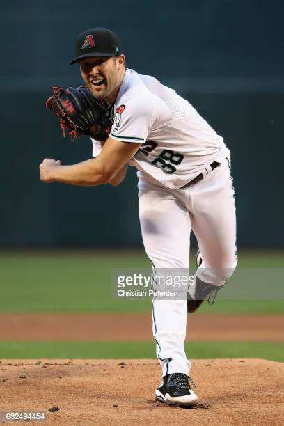 Starting pitcher Robbie Ray of the Arizona Diamondbacks throws a warm up pitch during the MLB game against the Detroit Tigers at Chase Field on May 9...