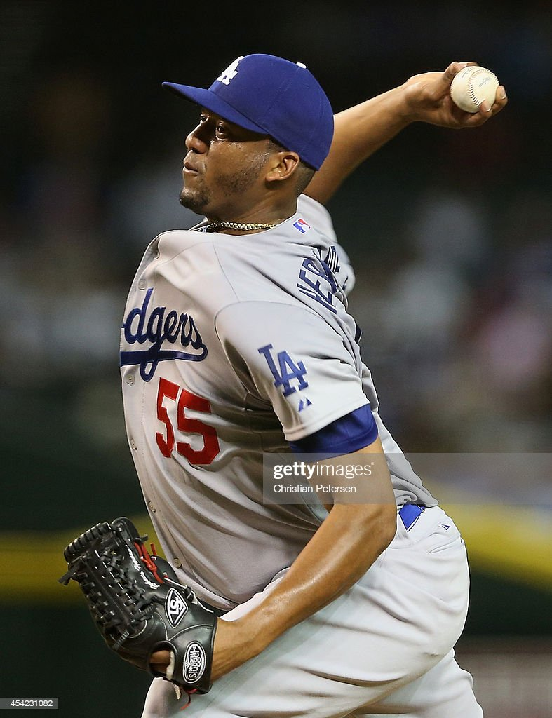 Starting pitcher Roberto Hernandez #55 of the Los Angeles Dodgers pitches against the Arizona Diamondbacks during the MLB game at Chase Field on August 26, 2014 in Phoenix, Arizona.