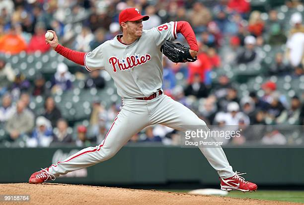 Starting pitcher Roy Halladay of the Philadelphia Phillies delivers against the Colorado Rockies at Coors Field on May 12 2010 in Denver Colorado The...