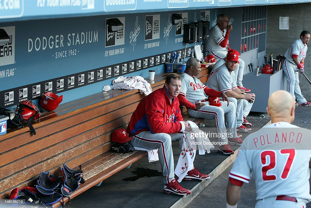 Starting pitcher <a gi-track='captionPersonalityLinkClicked' href=/galleries/search?phrase=Roy+Halladay&family=editorial&specificpeople=208782 ng-click='$event.stopPropagation()'>Roy Halladay</a> #34 of the Philadelphia Phillies looks on from the dugout prior to their MLB game against the Los Angeles Dodgers at Dodger Stadium on July 17, 2012 in Los Angeles, California. The Phillies defeated the Dodgers 3-2.