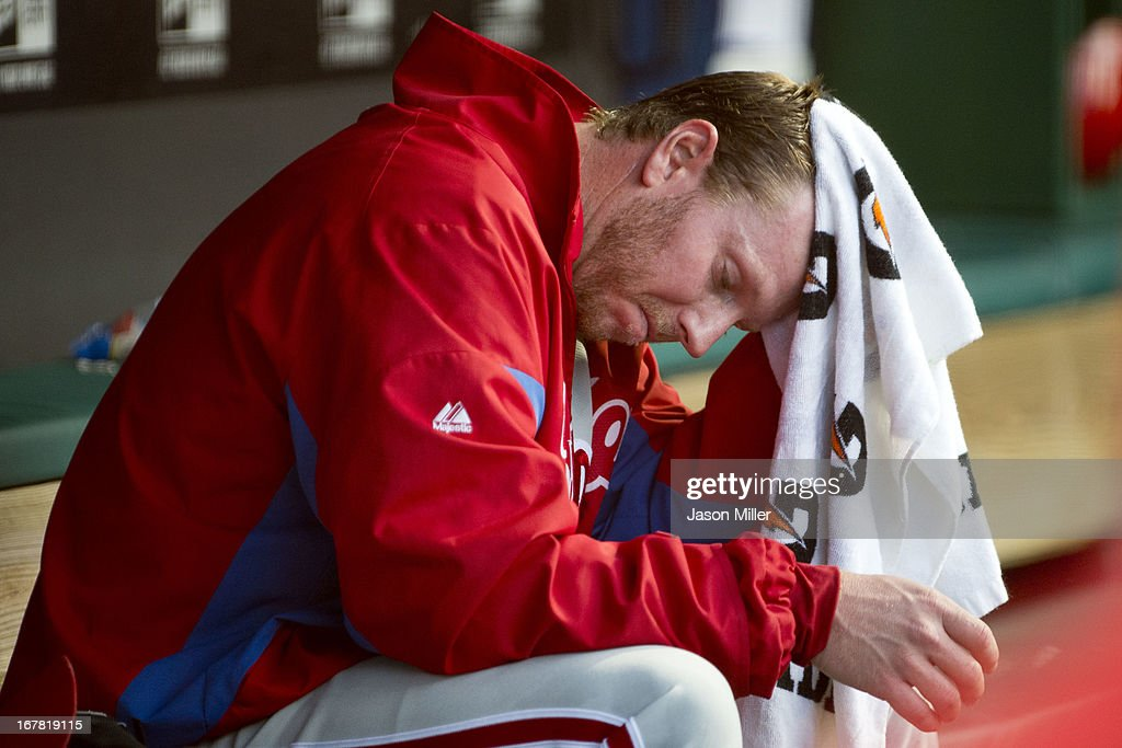 Starting pitcher <a gi-track='captionPersonalityLinkClicked' href=/galleries/search?phrase=Roy+Halladay&family=editorial&specificpeople=208782 ng-click='$event.stopPropagation()'>Roy Halladay</a> #34 of the Philadelphia Phillies reacts in the dugout after leaving the game during the fourth inning against the Cleveland Indians at Progressive Field on April 30, 2013 in Cleveland, Ohio.