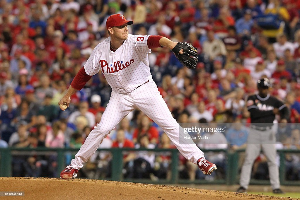 Starting pitcher <a gi-track='captionPersonalityLinkClicked' href=/galleries/search?phrase=Roy+Halladay&family=editorial&specificpeople=208782 ng-click='$event.stopPropagation()'>Roy Halladay</a> #34 of the Philadelphia Phillies throws a pitch during a game against the Miami Marlins at Citizens Bank Park on September 11, 2012 in Philadelphia, Pennsylvania.
