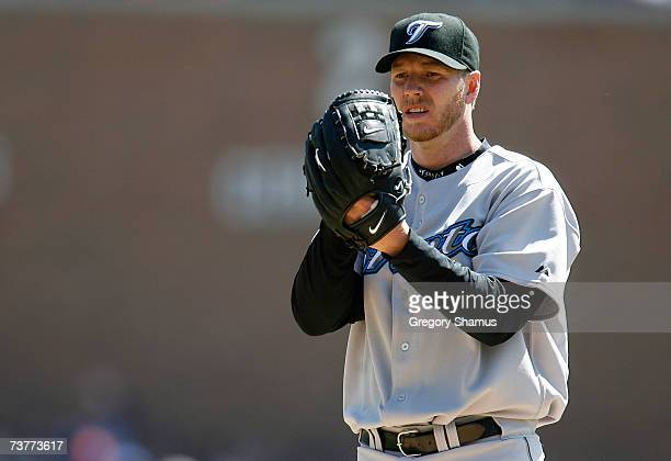Starting pitcher Roy Halladay of the Toronto Blue Jays looks towards the catcher for a sign as he gets set to throw a pitch against the Detroit...