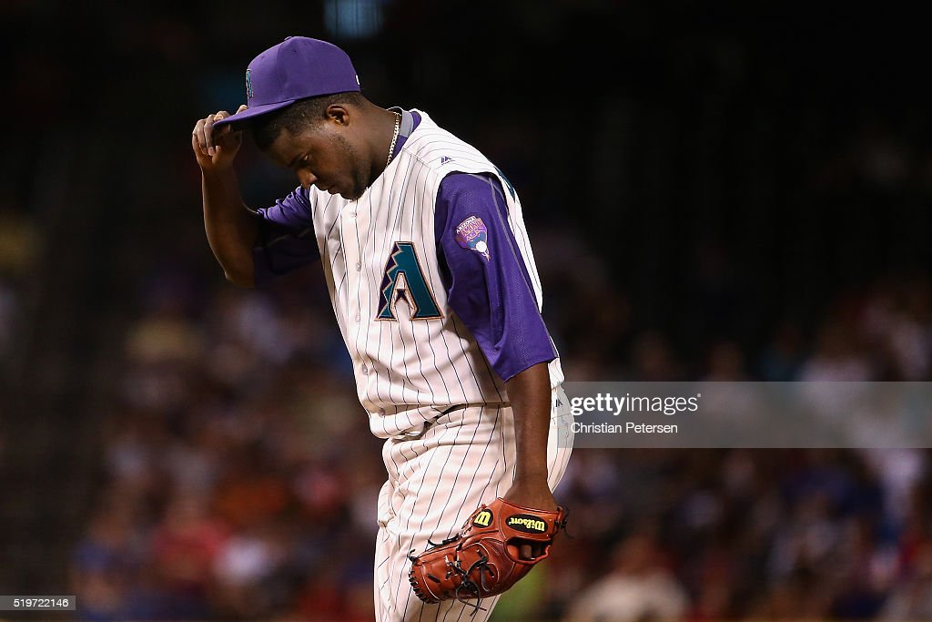 Starting pitcher <a gi-track='captionPersonalityLinkClicked' href=/galleries/search?phrase=Rubby+De+La+Rosa&family=editorial&specificpeople=7521869 ng-click='$event.stopPropagation()'>Rubby De La Rosa</a> #12 of the Arizona Diamondbacks reacts on the mound during the second inning of the MLB game at Chase Field on April 7, 2016 in Phoenix, Arizona.
