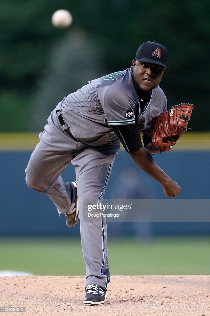 Starting pitcher <a gi-track='captionPersonalityLinkClicked' href=/galleries/search?phrase=Rubby+De+La+Rosa&family=editorial&specificpeople=7521869 ng-click='$event.stopPropagation()'>Rubby De La Rosa</a> #12 of the Arizona Diamondbacks delivers against the Colorado Rockies at Coors Field on May 10, 2016 in Denver, Colorado.