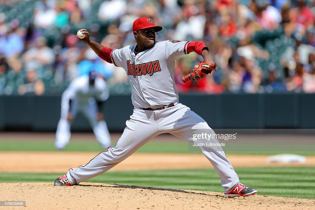 Starting pitcher Rubby De La Rosa of the Arizona Diamondbacks delivers to home plate during the sixth inning against the Colorado Rockies at Coors...