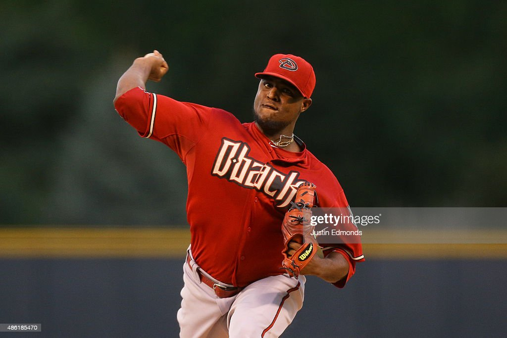 Starting pitcher Rubby De La Rosa of the Arizona Diamondbacks delivers to home plate during the first inning against the Colorado Rockies at Coors...