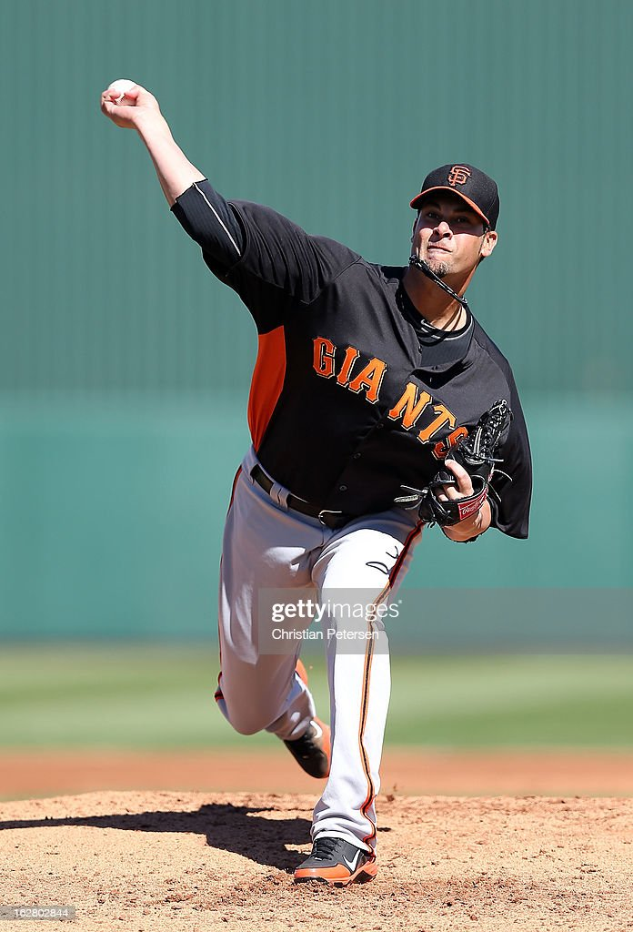 Starting pitcher <a gi-track='captionPersonalityLinkClicked' href=/galleries/search?phrase=Ryan+Vogelsong&family=editorial&specificpeople=670011 ng-click='$event.stopPropagation()'>Ryan Vogelsong</a> #32 of the San Francisco Giants pitches against the Los Angeles Angels during the spring training game at Tempe Diablo Stadium on February 27, 2013 in Tempe, Arizona.