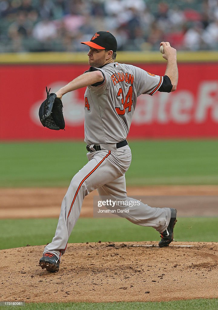 Starting pitcher <a gi-track='captionPersonalityLinkClicked' href=/galleries/search?phrase=Scott+Feldman&family=editorial&specificpeople=540379 ng-click='$event.stopPropagation()'>Scott Feldman</a> #34 of the Baltimore Orioles delivers the ball against the Chicago White Sox at U.S. Cellular Field on July 3, 2013 in Chicago, Illinois.