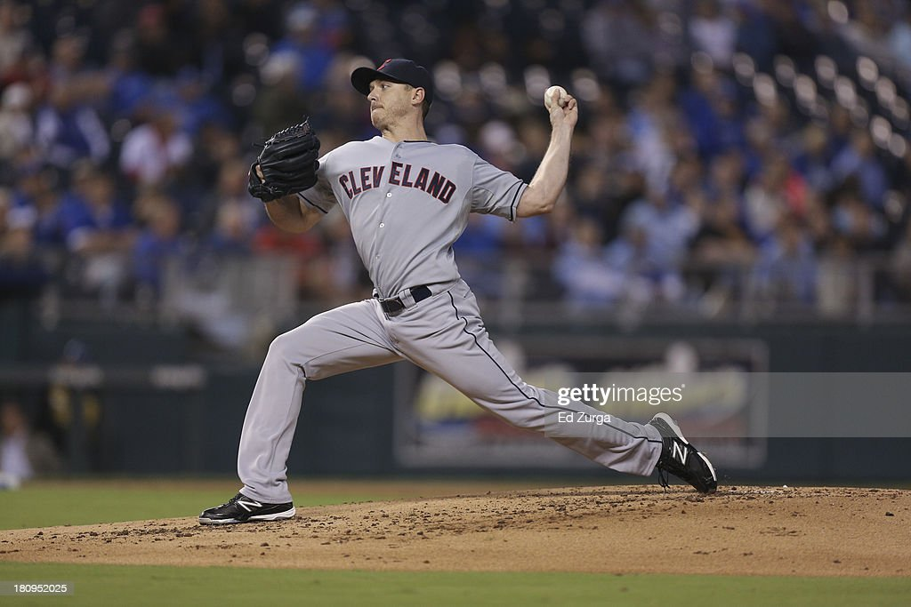 Starting pitcher <a gi-track='captionPersonalityLinkClicked' href=/galleries/search?phrase=Scott+Kazmir&family=editorial&specificpeople=217724 ng-click='$event.stopPropagation()'>Scott Kazmir</a> #26 of the Cleveland Indians throws against the Kansas City Royals at Kauffman Stadium on September 16, 2013 in Kansas City, Missouri.