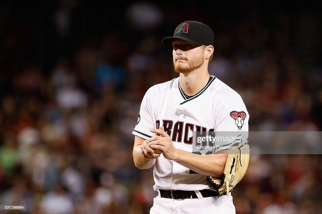 Starting pitcher <a gi-track='captionPersonalityLinkClicked' href=/galleries/search?phrase=Shelby+Miller&family=editorial&specificpeople=4761626 ng-click='$event.stopPropagation()'>Shelby Miller</a> #26 of the Arizona Diamondbacks reacts after giving up a three-run home run to Joe Panik (not pictured) of the San Francisco Giants during the sixth inning of the MLB game at Chase Field on May 13, 2016 in Phoenix, Arizona.