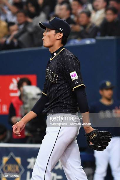 Starting pitcher Shintaro Fujinami of Japan reacts after allowing a run in the bottom of the first inning during the World Baseball Classic WarmUp...
