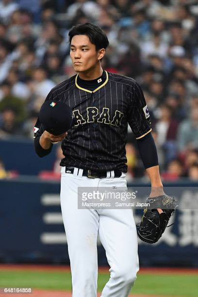 Starting pitcher Shintaro Fujinami of Japan reacts after the bottom of the first inning during the World Baseball Classic WarmUp Game between Japan...