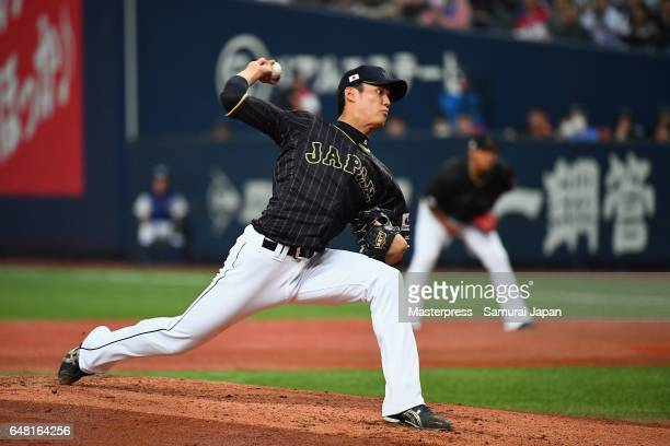 Starting pitcher Shintaro Fujinami of Japan throws in the bottom of the first inning during the World Baseball Classic WarmUp Game between Japan and...