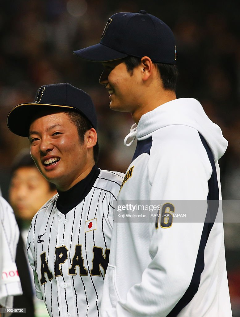 Starting pitcher Shohei Otani (R) #16 of Japan celebrates Yuki Matsui (R) #10 after their 5-0 win in the WBSC Premier 12 match between Japan and South Korea at the Sapporo Dome on November 8, 2015 in Sapporo, Japan.