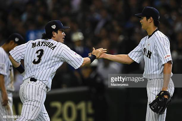 Starting pitcher Shohei Otani of Japan high fives with infielder Nobuhiro Matsuda after the top of seventh inning during the WBSC Premier 12 semi...