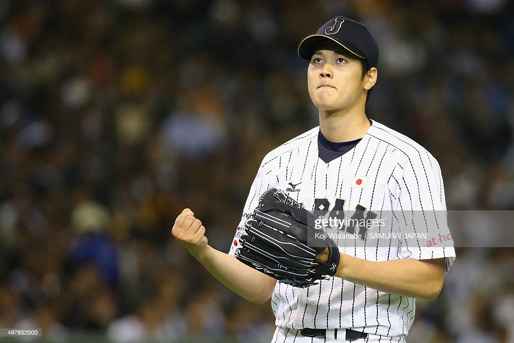 Starting pitcher Shohei Otani of Japan reacts after the top of first inning during the WBSC Premier 12 semi final match between South Korea and Japan...
