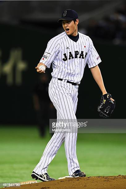 Starting pitcher Shohei Otani of Japan reacts in the top of first inning during the WBSC Premier 12 semi final match between South Korea and Japan at...