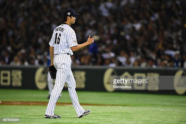 Starting pitcher Shohei Otani of Japan returns to dugout after the top of sixth inning during the WBSC Premier 12 semi final match between South...