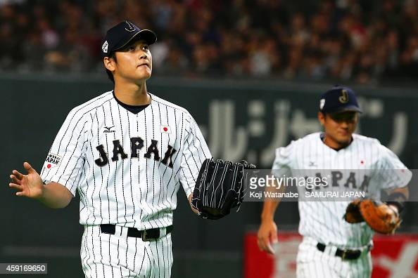 Starting pitcher Shohei Otani of Samurai Japan reacts in the first inning during the game five of Samurai Japan and MLB All Stars at Sapporo Dome on...