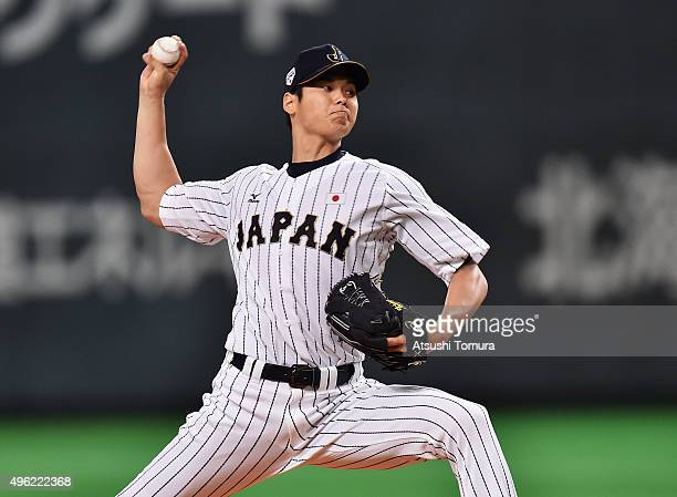 Starting pitcher Shohei Otani throws in the top of first inning during the WBSC Premier 12 match between Japan and South Korea at the Sapporo Dome on...