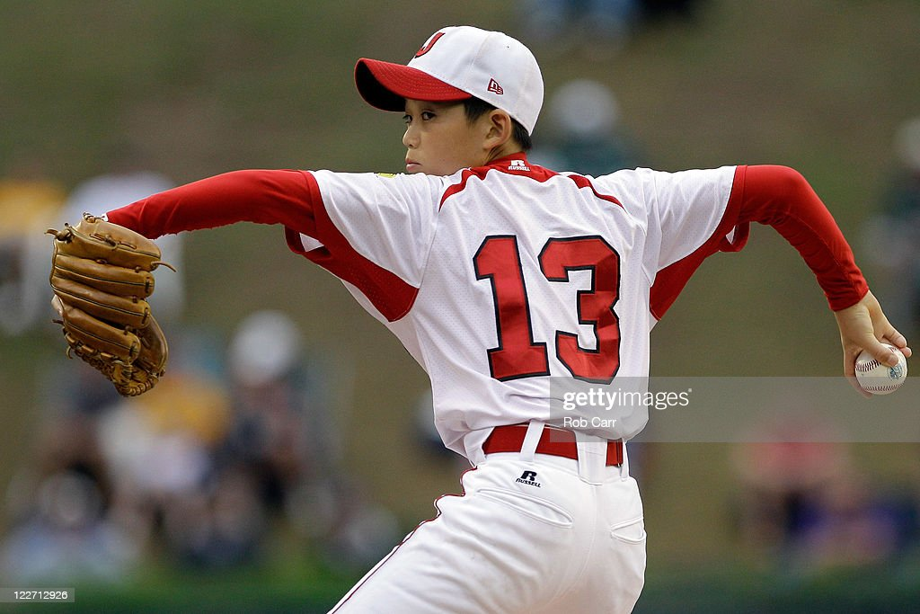 Starting pitcher Shoto Totsuka #13 of the Japan team from Hamamatsu City, Japan throws to a batter from the West team from Huntington Beach, California during the first inning of the Little League World Series championship game on August 28, 2011 in South Williamsport, Pennsylvania. The West team defeated the team from Japan 2-1.