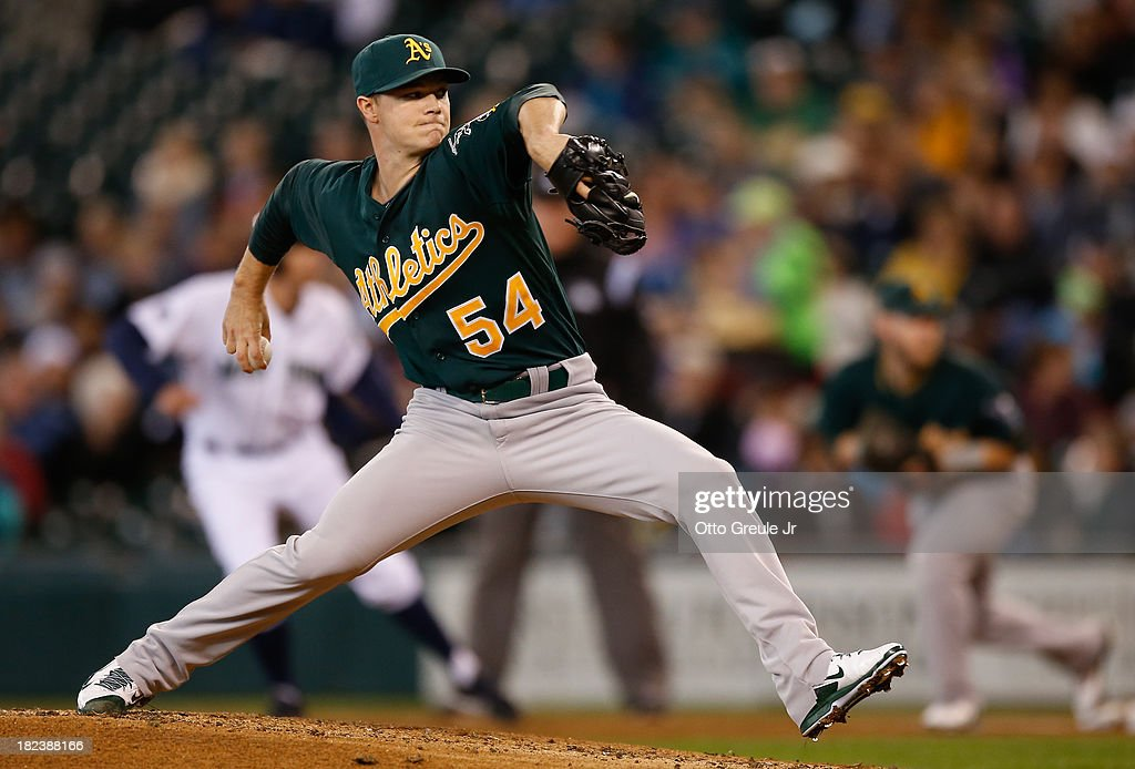 Starting pitcher <a gi-track='captionPersonalityLinkClicked' href=/galleries/search?phrase=Sonny+Gray&family=editorial&specificpeople=8046451 ng-click='$event.stopPropagation()'>Sonny Gray</a> #54 of the Oakland Athletics pitches in the first inning against the Seattle Mariners at Safeco Field on September 29, 2013 in Seattle, Washington.