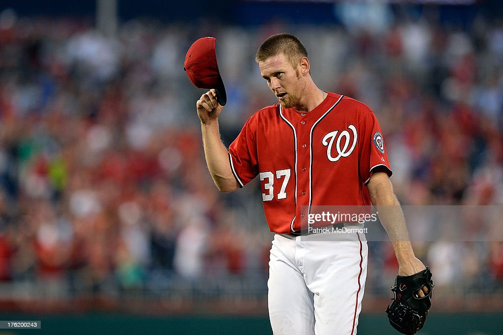 Starting pitcher <a gi-track='captionPersonalityLinkClicked' href=/galleries/search?phrase=Stephen+Strasburg&family=editorial&specificpeople=6164496 ng-click='$event.stopPropagation()'>Stephen Strasburg</a> #37 of the Washington Nationals celebrates after pitching his first complete game as the Nationals defeated the Philadelphia Phillies 6-0 during a game at Nationals Park on August 11, 2013 in Washington, DC.