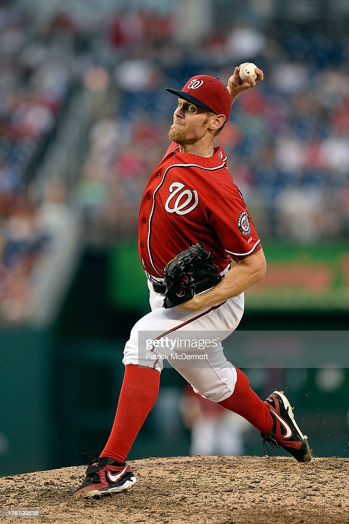 Starting pitcher <a gi-track='captionPersonalityLinkClicked' href=/galleries/search?phrase=Stephen+Strasburg&family=editorial&specificpeople=6164496 ng-click='$event.stopPropagation()'>Stephen Strasburg</a> #37 of the Washington Nationals throws a pitch against the Philadelphia Phillies in the ninth inning of a game at Nationals Park on August 11, 2013 in Washington, DC. Strasburg pitched the first complete game of his career as the Nationals defeated the Philadelphia Phillies 6-0.