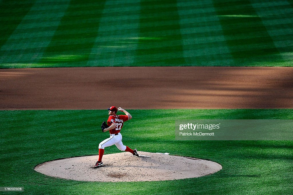 Starting pitcher <a gi-track='captionPersonalityLinkClicked' href=/galleries/search?phrase=Stephen+Strasburg&family=editorial&specificpeople=6164496 ng-click='$event.stopPropagation()'>Stephen Strasburg</a> #37 of the Washington Nationals throws a pitch against the Philadelphia Phillies during a game at Nationals Park on August 11, 2013 in Washington, DC.