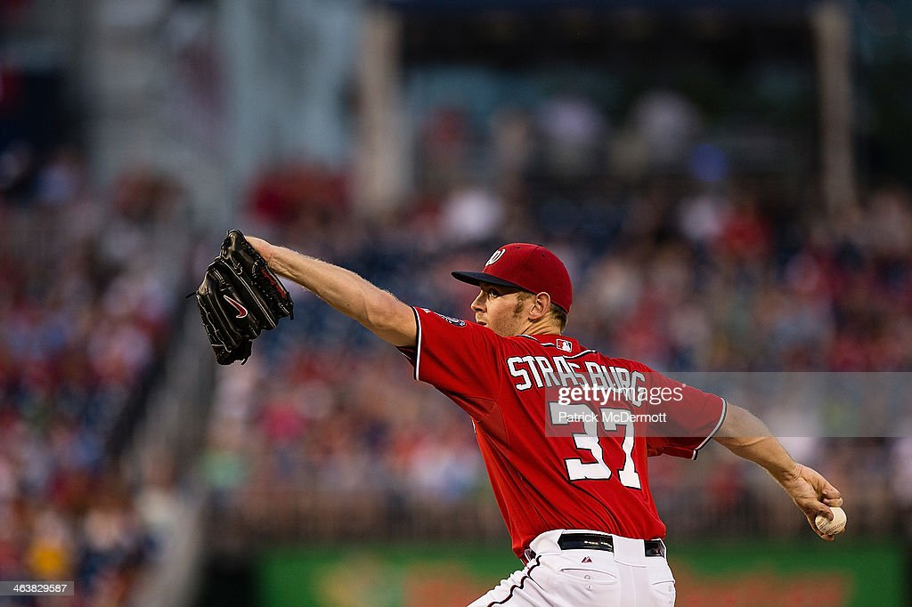 Starting pitcher <a gi-track='captionPersonalityLinkClicked' href=/galleries/search?phrase=Stephen+Strasburg&family=editorial&specificpeople=6164496 ng-click='$event.stopPropagation()'>Stephen Strasburg</a> #37 of the Washington Nationals throws a pitch against the Philadelphia Phillies during a game at Nationals Park on August 11, 2013 in Washington, DC. Strasburg pitched the first complete game of his career as the Nationals defeated the Philadelphia Phillies 6-0.