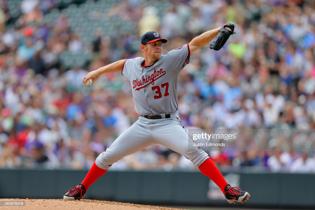 Starting pitcher <a gi-track='captionPersonalityLinkClicked' href=/galleries/search?phrase=Stephen+Strasburg&family=editorial&specificpeople=6164496 ng-click='$event.stopPropagation()'>Stephen Strasburg</a> #37 of the Washington Nationals delivers to home plate during the third inning against the Colorado Rockies at Coors Field on July 23, 2014 in Denver, Colorado.