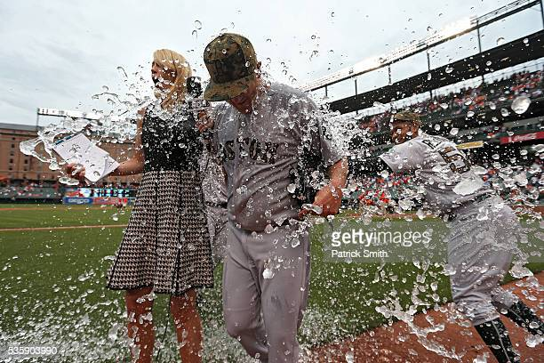 Starting pitcher Steven Wright of the Boston Red Sox is dunked by teammates after defeating the Baltimore Orioles at Oriole Park at Camden Yards on...