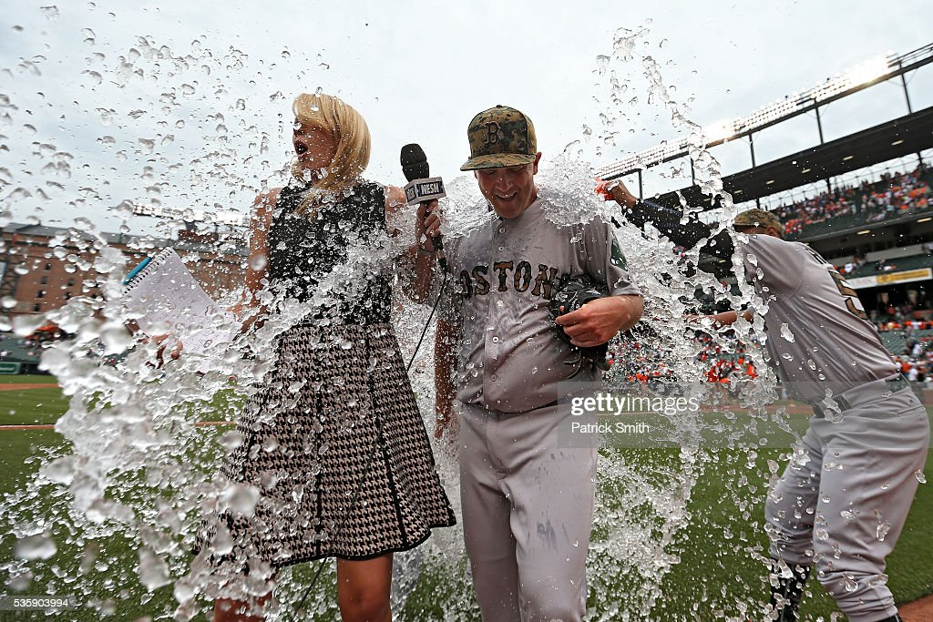 Starting pitcher <a gi-track='captionPersonalityLinkClicked' href=/galleries/search?phrase=Steven+Wright+-+Baseball+Player&family=editorial&specificpeople=14646404 ng-click='$event.stopPropagation()'>Steven Wright</a> #35 of the Boston Red Sox is dunked by teammates after defeating the Baltimore Orioles at Oriole Park at Camden Yards on May 30, 2016 in Baltimore, Maryland.