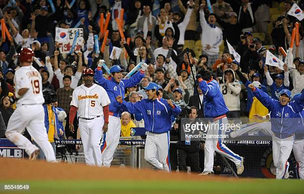 Starting pitcher SukMin Yoon of Korea celebrates with teammates after winning the semifinal game of the 2009 World Baseball Classic 102 over...