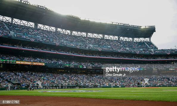 Starting pitcher Taijuan Walker of the Seattle Mariners throws the first pitch of the game during their home opener against Billy Burns of the...