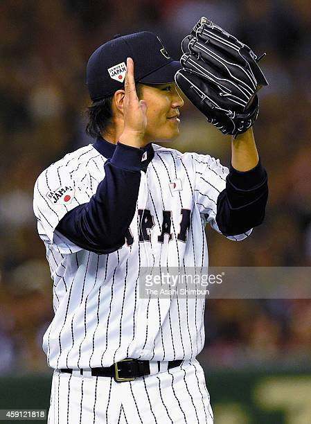 Starting pitcher Takahiro Norimoto of Samurai Japan applauds Ryosuke Kikuchi in the top of 3rd inning during the game three of Samurai Japan and MLB...