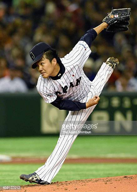 Starting pitcher Takahiro Norimoto of Samurai Japan delivers a pitch during the game three of Samurai Japan and MLB All Stars at Tokyo Dome on...