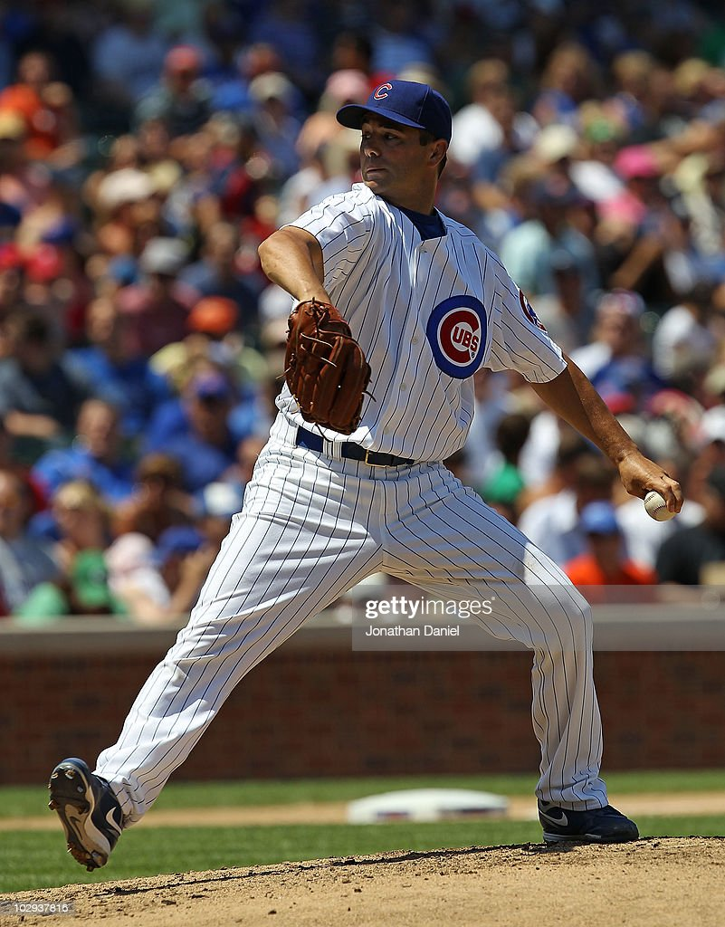 Starting pitcher Ted Lilly #30 of the Chicago Cubs delivers the ball against the Philadelphia Phillies at Wrigley Field on July 16, 2010 in Chicago, Illinois. The Cubs defeated the Phillies 4-3.