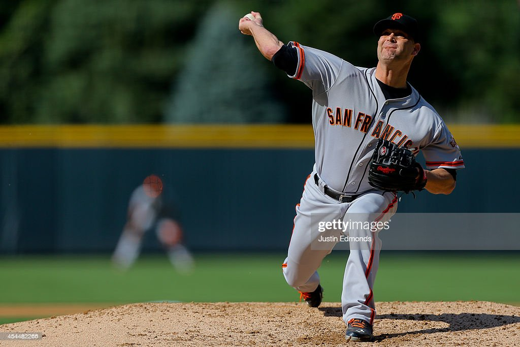 Starting pitcher <a gi-track='captionPersonalityLinkClicked' href=/galleries/search?phrase=Tim+Hudson&family=editorial&specificpeople=203108 ng-click='$event.stopPropagation()'>Tim Hudson</a> #17 of the San Francisco Giants delivers to home plate during the first inning against the Colorado Rockies at Coors Field on September 1, 2014 in Denver, Colorado.