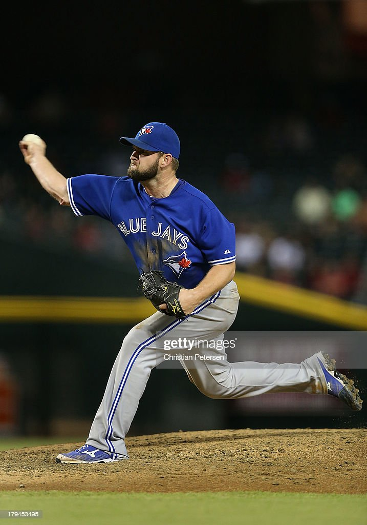 Starting pitcher Todd Redmond #58 of the Toronto Blue Jays pitches against the Arizona Diamondbacks during the interleague MLB game at Chase Field on September 3, 2013 in Phoenix, Arizona.