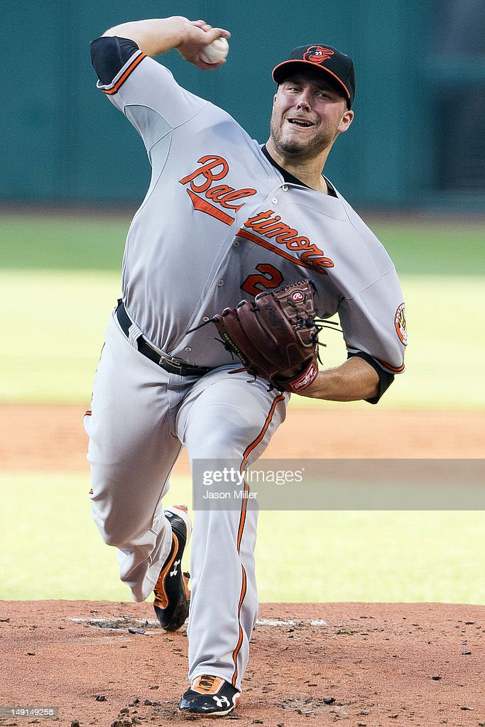 Starting pitcher Tommy Hunter #29 of the Baltimore Orioles pitches during the first inning against the Cleveland Indians at Progressive Field on July 23, 2012 in Cleveland, Ohio.