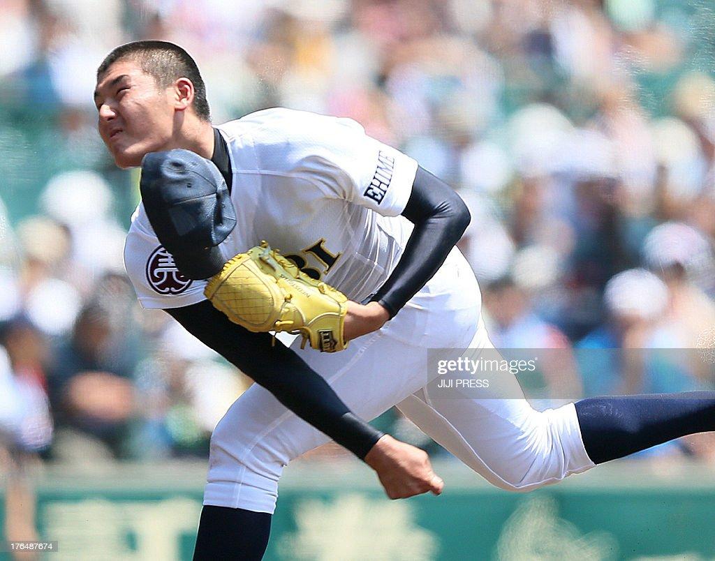 Starting pitcher Tomohiro Anraku of Saibi High School throws during the second round game against Mie High School in the National High School...