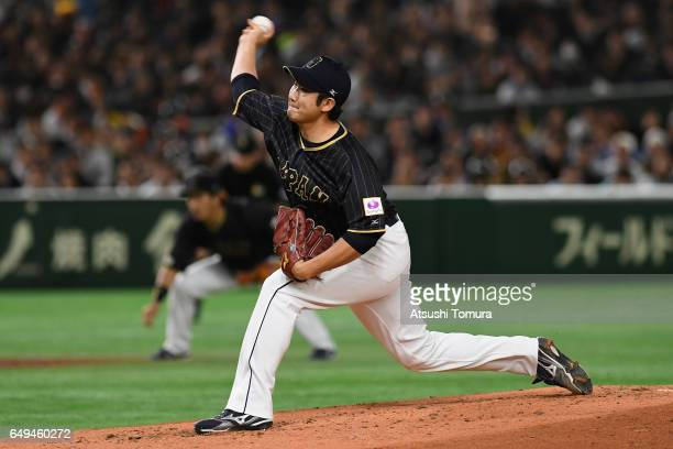 Starting Pitcher Tomoyuki Sugano of Japan throws in the bottom of the first inning during the World Baseball Classic Pool B Game Three between Japan...