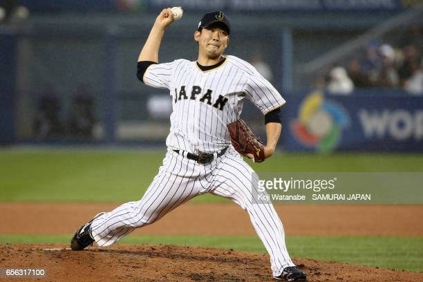 Starting pitcher Tomoyuki Sugano of Japan throws in the top of the first inning during the World Baseball Classic Championship Round Game 2 between...
