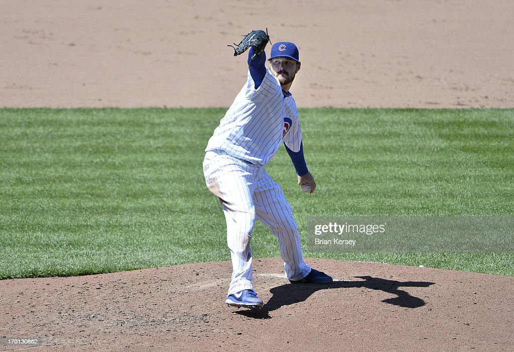Starting pitcher <a gi-track='captionPersonalityLinkClicked' href=/galleries/search?phrase=Travis+Wood&family=editorial&specificpeople=805314 ng-click='$event.stopPropagation()'>Travis Wood</a> #37 of the Chicago Cubs delivers during the sixth inning against the Pittsburgh Pirates at Wrigley Field on June 7, 2013 in Chicago, Illinois.