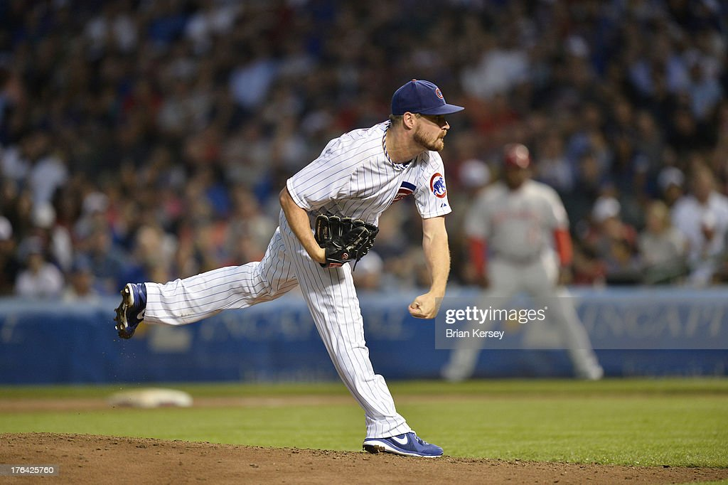 Starting pitcher <a gi-track='captionPersonalityLinkClicked' href=/galleries/search?phrase=Travis+Wood&family=editorial&specificpeople=805314 ng-click='$event.stopPropagation()'>Travis Wood</a> #37 of the Chicago Cubs delivers during the fifth inning against the Cincinnati Reds at Wrigley Field on August 12, 2013 in Chicago, Illinois.