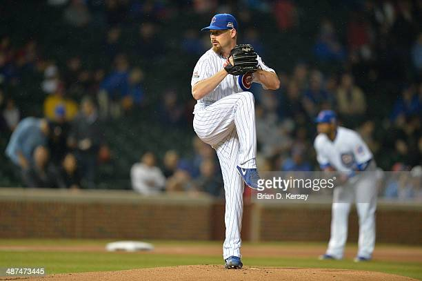 Starting pitcher Travis Wood of the Chicago Cubs delivers during the first inning against the Arizona Diamondbacks at Wrigley Field on April 21 2014...