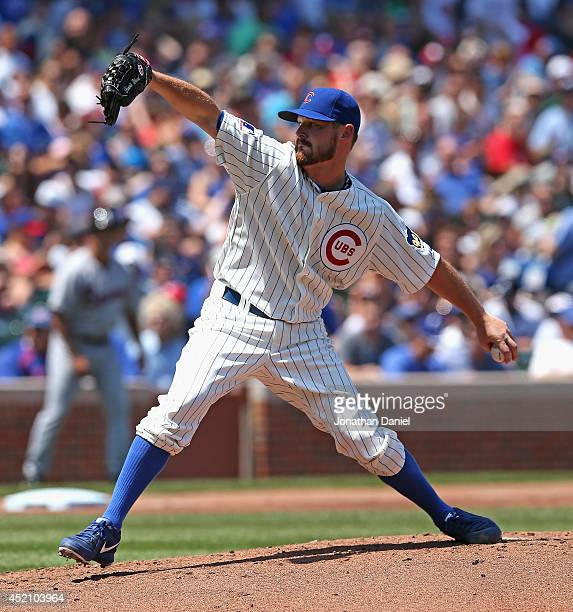 Starting pitcher Travis Wood of the Chicago Cubs delivers the ball against the Atlanta Braves at Wrigley Field on July 13 2014 in Chicago Illinois