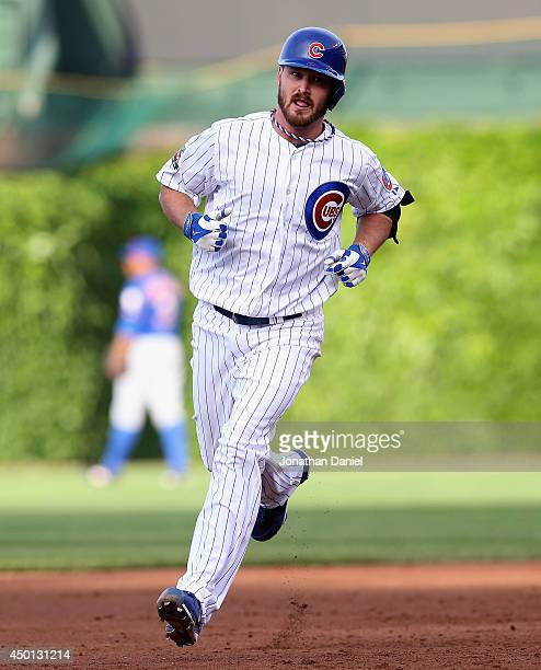 Starting pitcher Travis Wood of the Chicago Cubs runs the bases after hitting a tworun home run in the 2nd inning against the New York Mets at...